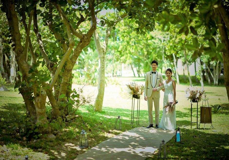 石垣リゾートホテル沖縄・ガーデン挙式 フォレスト・ガーデン・ウェディング 広大なガーデンより挙式会場入場シーン